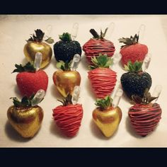 Chocolate covered strawberries with a Malibu Rum shot.  Black, red and gold.