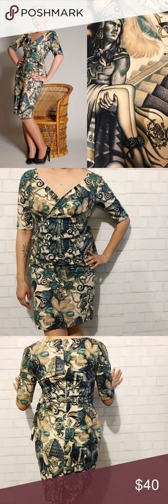"""Day of the dead Limb Pinup Dress In perfect condition in such a beautiful print . It's made in England . Tag reads a size 10 . I would consider this a XS / S . Read the measurements for reference. Chest : 16"""" inches .. waist : 13.5"""" inches .. hips : 18"""" inches .. 36"""" inches in length . Limb Dresses"""