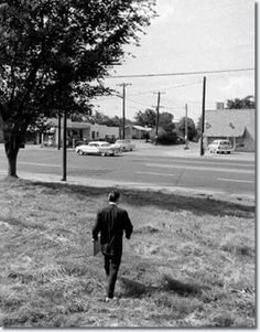 Walking to his Audubon Drive home from the train stop . Elvis had requested they stop before they reached the train station , Memphis , Tennessee , July 4 , 1956
