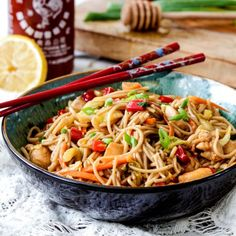Sweet and spicy Honey Sriracha Chicken Noodle Bowls smothered in the most delectable sauce!