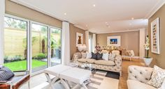 Tons of natural light shines into this home thanks to the cream interiors and large doors leading to the garden area. Kings Home, Natural Light, Homes, Interiors, Cream, Gallery, Garden, Houses, Custard