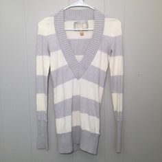 S H I R T Item: American Eagle V-Neck Sweater  Condition: Worn a couple of times and in excellent condition  Details: - V-neck - Gray and cream stripes - Warm material  Price: Negotiable American Eagle Outfitters Tops