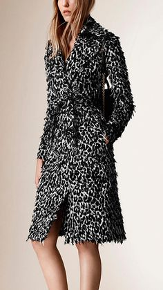 Burberry slim-fit trench coat in animal-print fil coupé. The distinctive frayed edges give the design a textured finish. Discover the women's outwear collection at Burberry.com