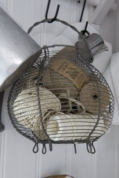 egg basket as storage for string & twine. Great way to repurpose an egg basket for those of us who don't gather eggs on a daily basis. Vintage Accessoires, Wire Baskets, Wire Basket Decor, Wire Egg Basket, Wood Basket, Sisal, Decoration, Crates, Repurposed