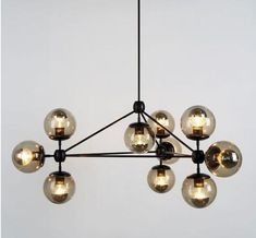 LOOOOVE! Hmm, wonder if stephen would be upset if I change out the brand new chandelier in the kitchen. Brooklyn-based Jason Miller's Modo Chandelier.