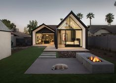 A tranquil garden + fire-pit in this contemporary home. Escobar Renovation, a 1930s Phoenix, Arizona home renovated and expanded by US design firm Chen + Suchart Studio.