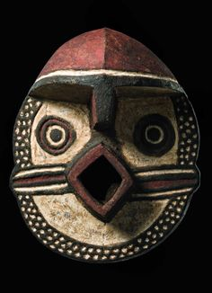Africa | Face mask from the Nunuma people of Burkina Faso | Wood, encrusted patina and polychrome paint.