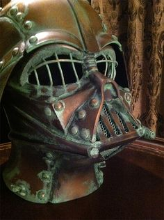 Steampunk Darth Vader! I think it qualifies more as dieselpunk, but that is just me. Acctually that was < her as for > me i'm thinking reptillian torture mask - or possibly an Inferi mask? what do you think >
