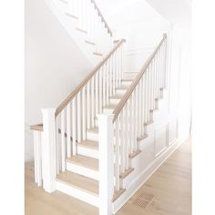 The straight White Staircase. White Staircase Paint color is Benjamin Moore Simply White.