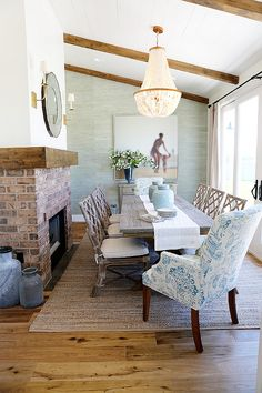 Coastal Dining Room with coastal capiz chandelier. #capizchandelier #coastal #diningroom #chandelier Millhaven Homes.