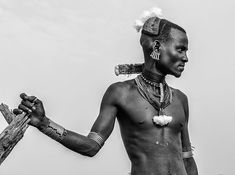 A Maza from Hamar tribe of Omo Valley. Mazas are men who have succesfully completed their Bull Jumping ceremony. See my previous posts on Bull Jumping. #Maza #Hamar #tribes Omo Valley #Ethiopia #Africaportrait #bnw #bnwworld #portrait #man #People_Infinity_ #Bulljumping #omovalley #canon_photos #instatravel #travel #natgeo #picoftheday #TravelPics #travel #instatravel #travelgram #passportready #travelblogger #wanderlust #ilovetravel #instatravelling #instavacation#portraitsfromtheworld…