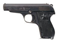 """Rarely seen outside of North Korea, the Type 70 pistol is a local design. It has elements of the Walther PP, Makarov, and the Browning Model 1910 pistols: a hammer-fired simple blowback mechanism, exposed serrated ring hammer, fixed sights, and one piece wraparound plastic grips with a large distinctive star molded at the top of both sides. The slide is marked with Korean characters, a circled star, and """"7.62"""". It is chambered for the 7.65mm Browning Auto caliber."""
