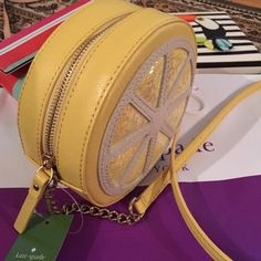 "Kate Spade Micha Kate Spade Lemon Street  Micha.  COLOR:  Limoncello (731) SIZE: 6"" (L) x 6"" (H) x 2.5"" (W) with leather and chain crossbody strap, drop 20"" -genuine leather with sequins -custom woven interior signature lining -14-karat gold plated hardware -round cross body -top zipper closure -exterior front features lemon slice in sequins -exterior rear embossed Kate Spade New York signature logo on genuine leather kate spade Bags"