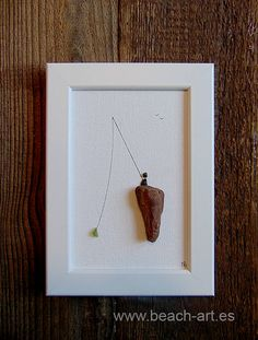 Thank you for visiting Beach-Arts online store! Enjoy this lovely scene of a lonely fisherman on a rock. On the long angling rod he has caught a green piece of sea glass. This home decoration is handmade with little pebbles and sea glass from the beach. Its a perfect gift for a