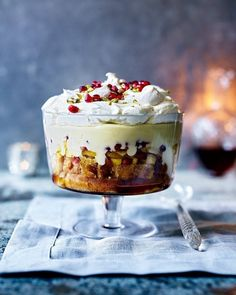 Dare we say that this trifle is even better than your grandma's? Yes, of course we do 😏 (find the recipe for this caramelised pineapple and coconut trifle with rum syllabub in the December collector's edition of delicious. Köstliche Desserts, Dessert Recipes, Plated Desserts, Zabaglione Recipe, Christmas Trifle, Christmas Pudding, Fudge, Coconut Custard, Trifle Desserts