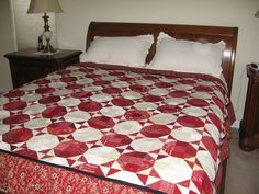 A favorie red and cream quilt made bt Nicole of sisterschoice.typepad.com