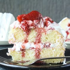 Tender butter cake layered with fluffy whipped cream and mascarpone frosting and juicy roasted strawberries!