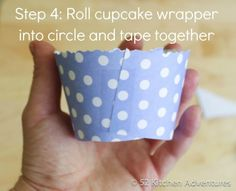 Step 4 Roll cupcake wrapper and tape together