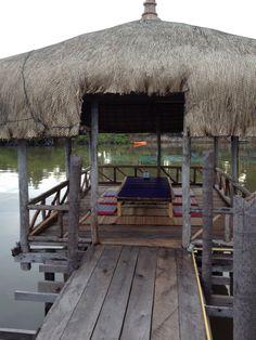 Tiki Huts at Thmorda Crab House built on stilts above the Kah Bpow River, Koh Kong, Cambodia