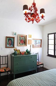 Love the bright orange chandelier.