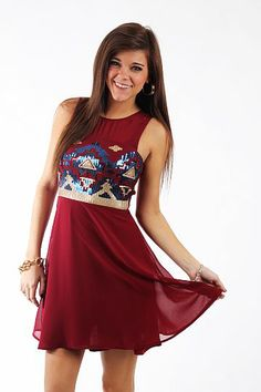 "Sheer Tribal Dress, Burgundy $44.00 OMG this dress is AMAZING!!! The silhouette is beautiful and we love the sheer overlay, but the best part are the sequined tribal patterns on the bodice. You can wear this one all year long, but we think it will be perfect for your holiday parties!   Fits true to size. Miranda is wearing a small.   From shoulder to hem:  Small - 33.5""  Medium - 34""  Large - 35"""