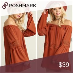 Off Shoulder Bell Sleeved Tunic Cotton blend rust colored tunic features bell sleeves with crochet lace detail, off shoulder style, crochet detail across the front Tops Tunics