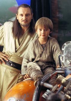 "Publicity shot of Qui-Gon Jinn (Liam Neeson) and Anakin Skywalker (Jake Lloyd) for ""Star Wars: Episode I - The Phantom Menace - 1999."
