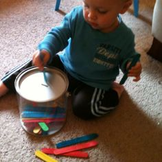 Toddler Craft Stick Drop - Push sticks into slot one at a time and watch them collect in clear container.