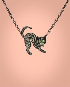 Black Cat Necklace from Eldorado Club  - Cross paths with this fierce creature  a hand carved black cat with glittering green gem eyes hangs from a black chain.  Another stunning design from Eldorado Club, made in the USA.
