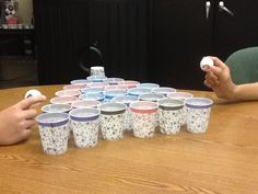 Bounce the ball into a cup. Say the word, use it in a sentence, synonym/antonym for it ...