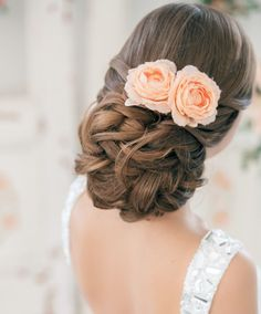 love the hair and flowers but in the flowers should be the color of your bridesmaid dresses
