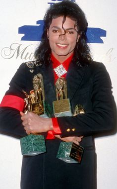 Take a look. At the awards. In this man's hands.