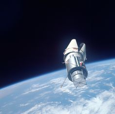 Planet Earth and the Agena Target Vehicle as seen from the Gemini 9 space capsule, June 4, 1966.