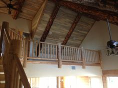 Blue ponderosa pine ceiling with real log beams