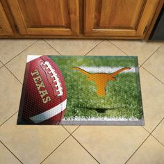 University of Texas Scraper Mat 19x30 - Ball - Scraper Mats by Sports Licensing Solutions are great for showing off your team pride in high traffic areas! Scraper Mats have nibs that scrape shoes clean of dirt, debris, and moisture so that your home stays clean. The debris is then trapped below the walking surface. Clean up is a breeze, just use a hose. Rubber construction ensures durability and mat features a high resolution image that won't fade! Textured backing keeps mat in place.FANMATS…