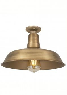 This eye-catching Vintage Industrial Flush Mount Farmhouse Ceiling Light by Industville with its flush mount design is perfect for interiors with lower-ceilings or less hanging space.