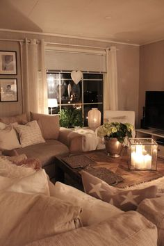 Love this cozy living room- curtains, lights
