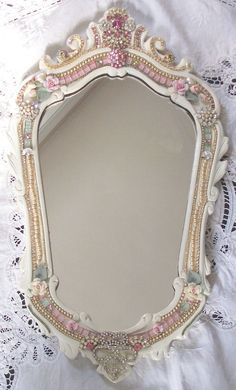 Vintage Mirror embellished with mix of vintage and new jewelry and glass.