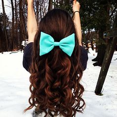 curly with a bow.