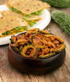 Karela Sabzi has a taste like no other because it is made from Bitter Gourd - a vegetable that you either like or dislike; there is no middle ground. While a dish with a tangy,  bitter-sweet flavor may not be for everyone, the nutritional value alone warrants a try! This incredibly nutritious, uniquely flavored version comes from a dhaba (roadside cafe/truck stop) in the Indian State of Punjab where it was served alongside steamed basmati rice, tamatar shorba, and fresh, warm chapatti