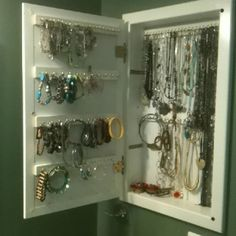"Bathroom medicine cabinet turned into jewelry ""armoire"" - Broke out old shelves, spray painted scrap wood, drilled holes and put in hooks, put pieces in with caulk, let dry overnight. Tada!"