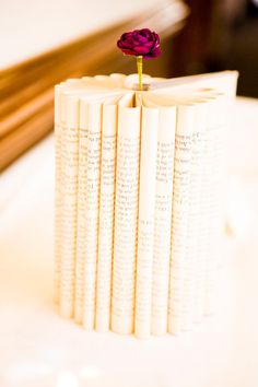 book centerpieces - a book with folded pages to look like a flower