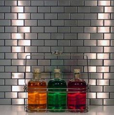Aluminum subway tile (saw this tile on Property Brothers tonight @HGTV and LOVED the final look with white cabinets and a dark wood table.)