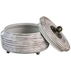Chic yet simple, this transitional decorative box is made with a steel and ceramic construction for lasting style.