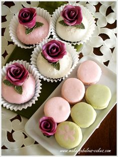 #Rose Cupcakes & Macarons_The first flower that came to my mind were roses_it is my favorite, so rose it is._The filling was made with white chocolate ganache infused with #rosewater. I absolutely love the resulting combination. The smoothness of the ganache blended very well with the sensuous flavor of the #rosewater. It paired perfectly with the nutty macaron shells._Since I was in a rosy mood, I made cupcakes decorated with, you guessed it - roses.