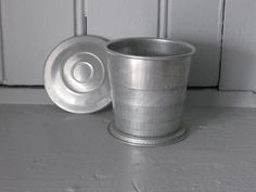 1960s Tin Collapsible Camping Drinking Cup. I loved mine!  I thought it was sooooo groovy!!!!!