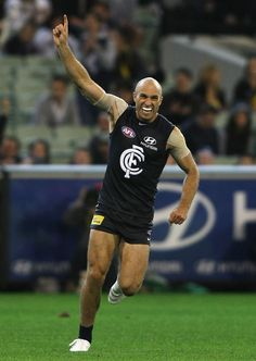 Chris Judd celebrates a goal during the Round 1 match against the Tigers at the MCG in 2011.