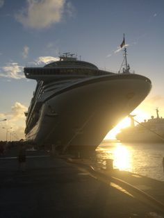 P&o Azura in caribbean sun setting back drop