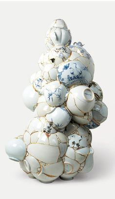 Yee_Sookyung Korean artist takes broken pottery shards and fuses them with 24kt gold into sculptures