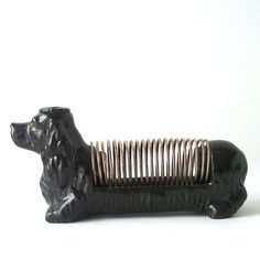 vintage dog letter holder pen 1950's mid century modern black poodle terrior office metal spiral home decor decorative figurine. $18.00, via Etsy.